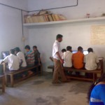 Vinod teaching the students