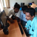 Trainers trying their hand at HTML practicals