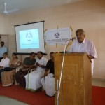 Ommen Chandy addressing the audience