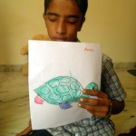 Rahul, a differently abled boy, with his drawing