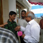 A student welcomes Dr. Srivastava