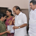 The minister presenting certificate to a student